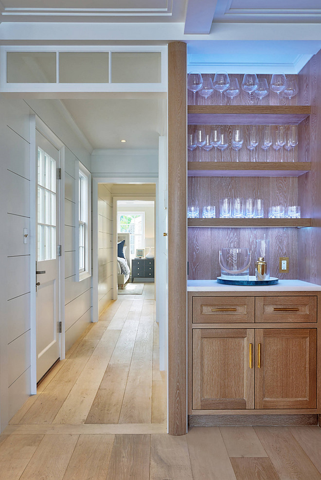 White Oak Bar with under cabinet lighting This White Oak cabinet features chunky shelves and under cabinet lighting Bar under cabinet lighting White Oak Bar with under cabinet lighting #WhiteOakcabinet #Bar #undercabinetlighting