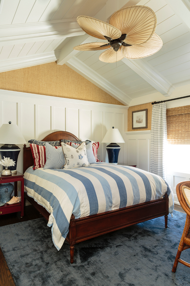 Coastal bedroom with board and batten and vaulted ceilings