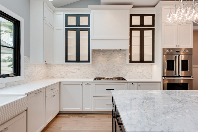 White kitchen with shaker-style cabinets and marble backsplash White kitchen with shaker-style cabinets and marble backsplash #Whitekitchen #shakerstylecabinets #marblebacksplash