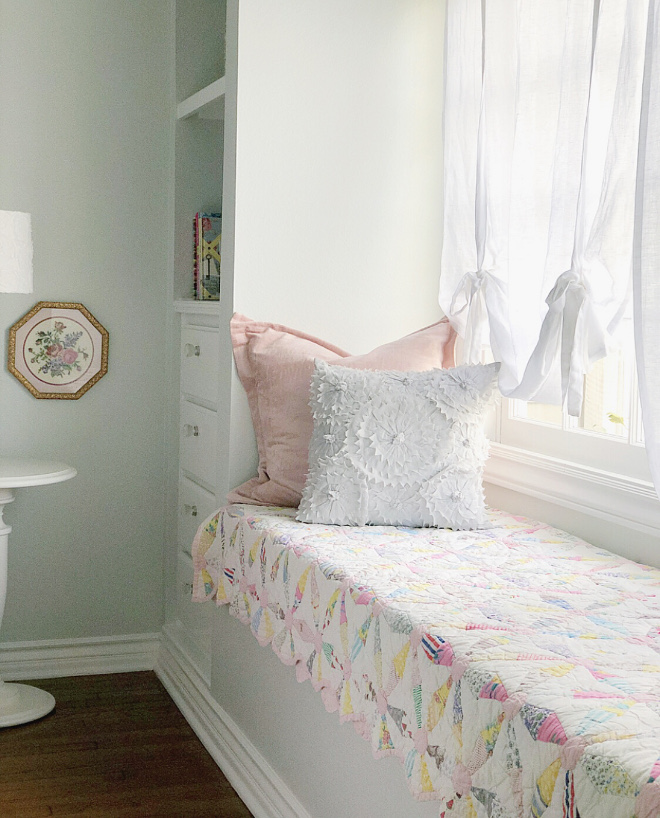 Quilt on window-seat cute idea