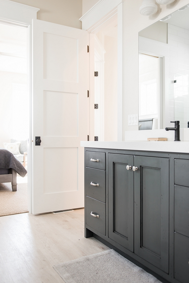 Neutral Bathroom with grey cabinet