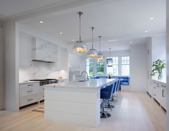 Modern White Kitchen with bleached hardwood floors Modern White Kitchen #ModernWhiteKitchen