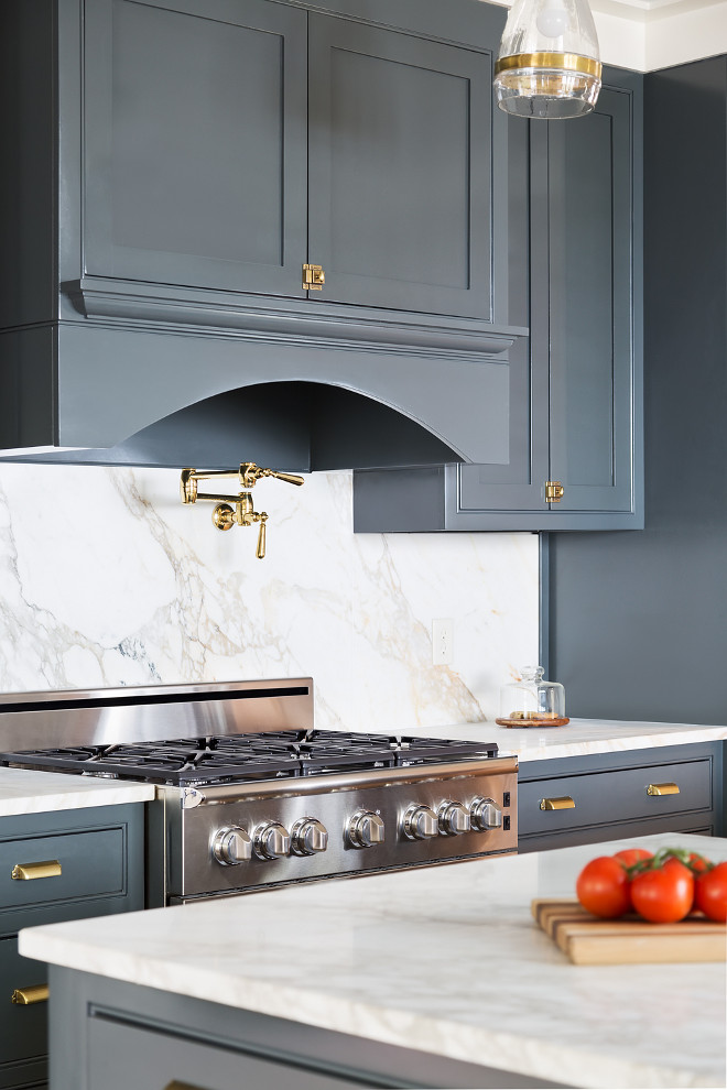 Kichen with brass hardware. Navy Grey Kitchen cabinets with brass cabinet Hardware is shared on HomeBunch