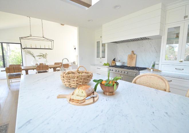 solid slab backsplash anc countertop are Carrara Marble