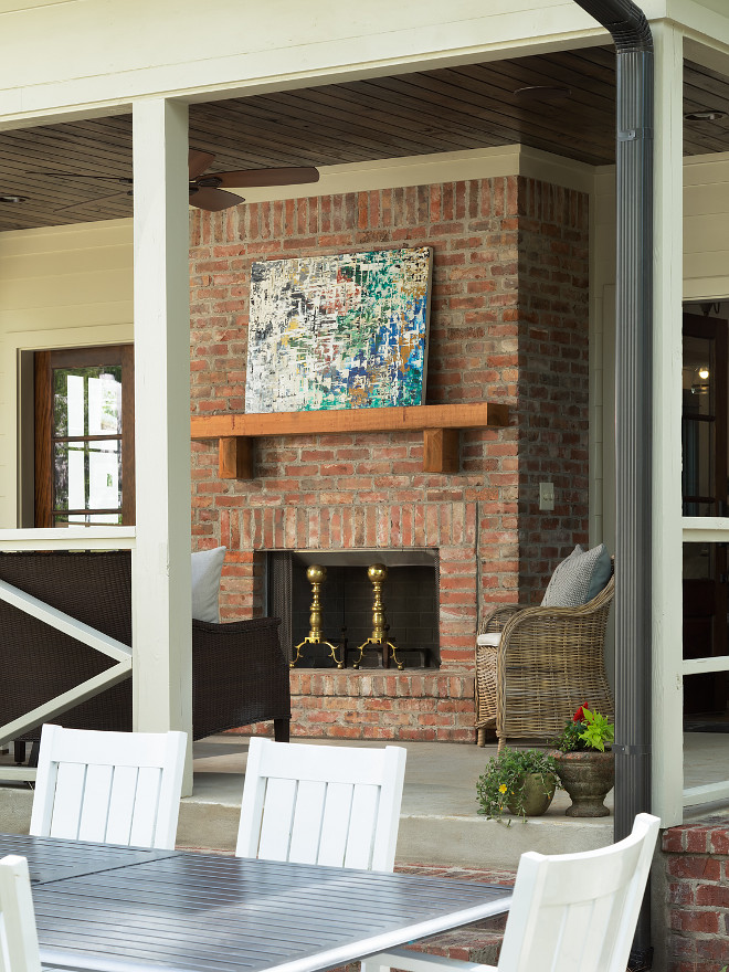 Outdoor Brick Fireplace with timber mantel sources on Home Bunch
