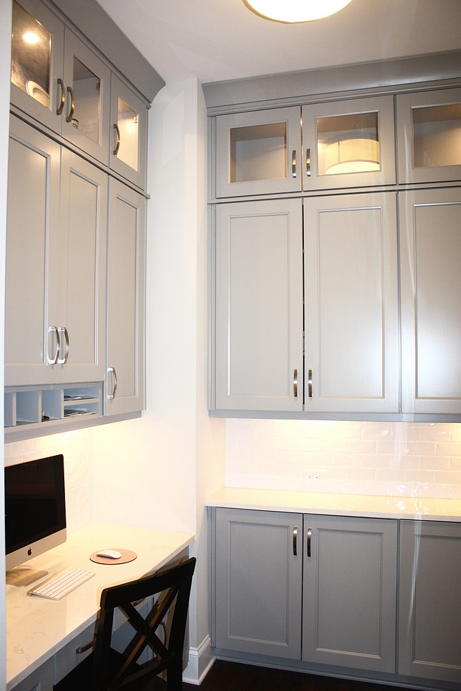 Grey cabinet with white backsplash tile and white quartz countertop