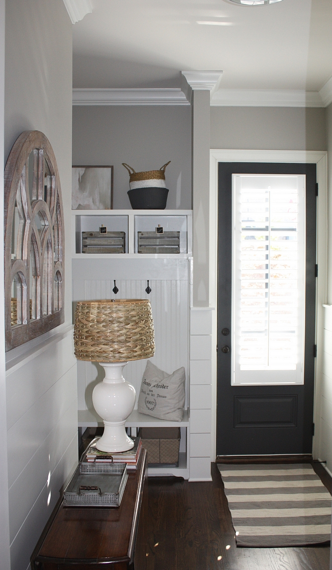 Small mudroom with grey interior door painted in Benjamin Moore Wrought Iron