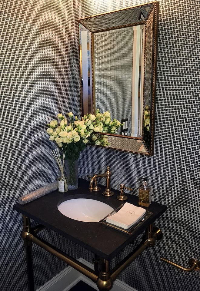 Powder room with textured wallpaper and silver bead mirror sources on Home Bunch #texturewallpaper