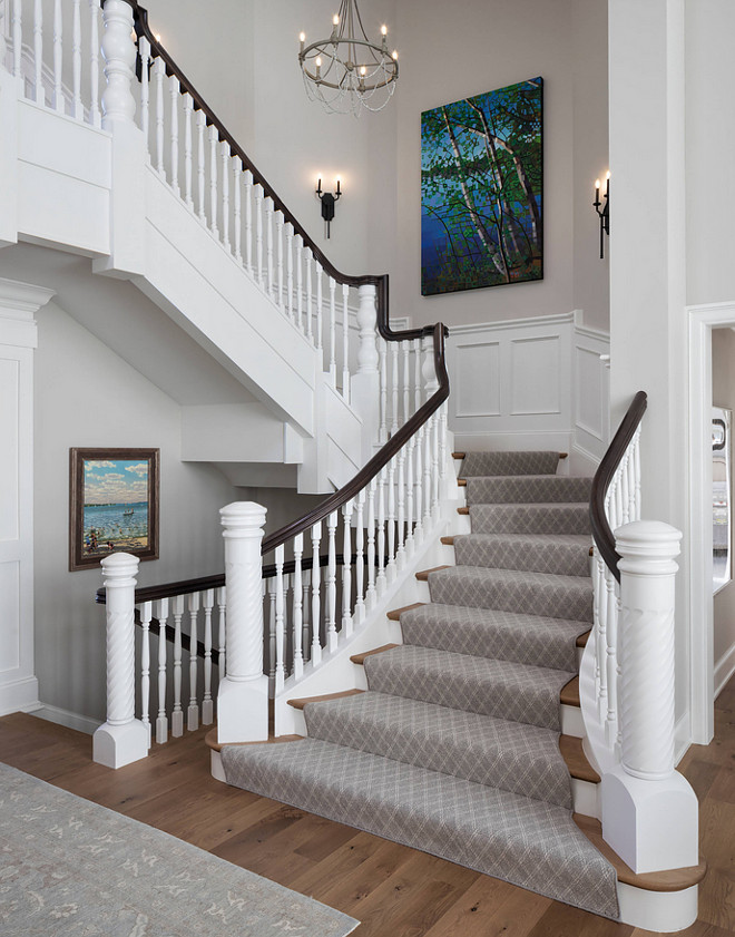 Traditional Staircase Traditional Staircase with grey runner and custom millwork Traditional Staircase #TraditionalStaircase #Staircaserunner #Staircasemillwork