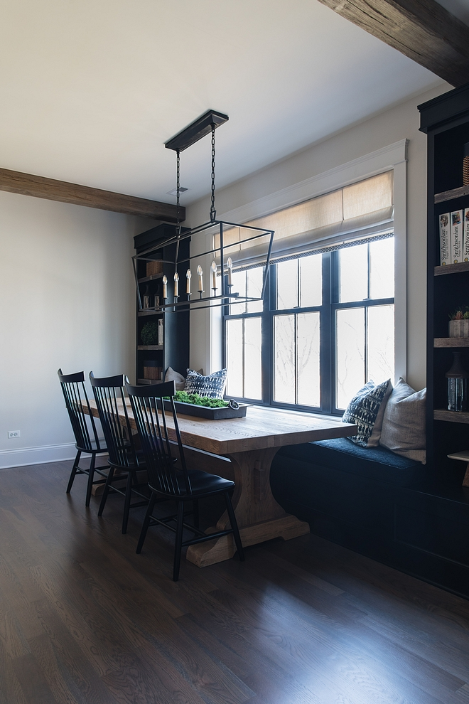 Farmhouse Dining room with banquette and bookcases