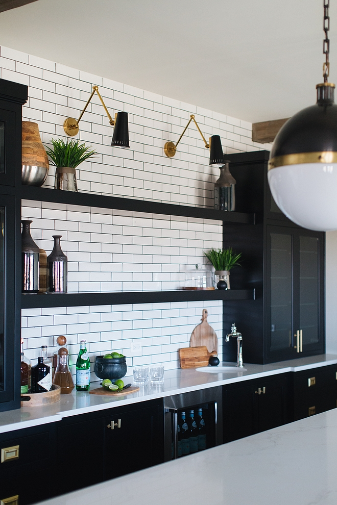 Black cabinets with white subway tile and long floating shelves Black cabinets with white subway tile and long floating shelves Black cabinets with white subway tile and long floating shelves #Blackcabinets #whitesubwaytile #floatingshelves