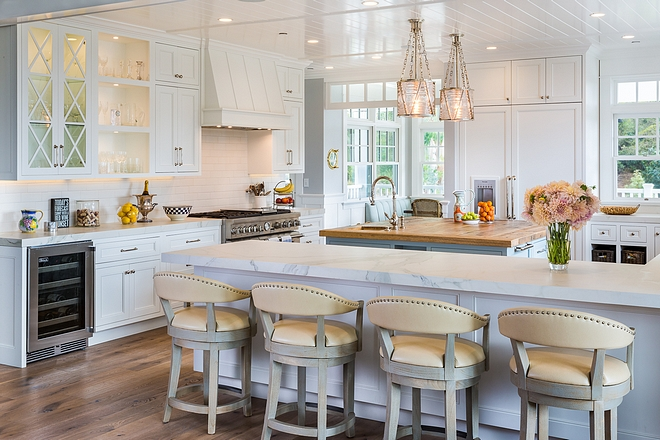 Beach House Kitchen with white cabinets and white oak hardwood floors paint color on Home Bunch #Kitchen #BeachHouseKitchen