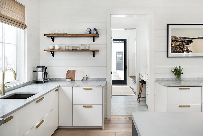 Modern farmhouse kitchen with Carrara marble countertop open shelves shiplap and Satin brass faucet