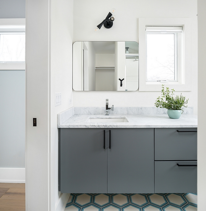 Bathroom Modern vanity painted in a grey paint color with Hex Bathroom floor Tile