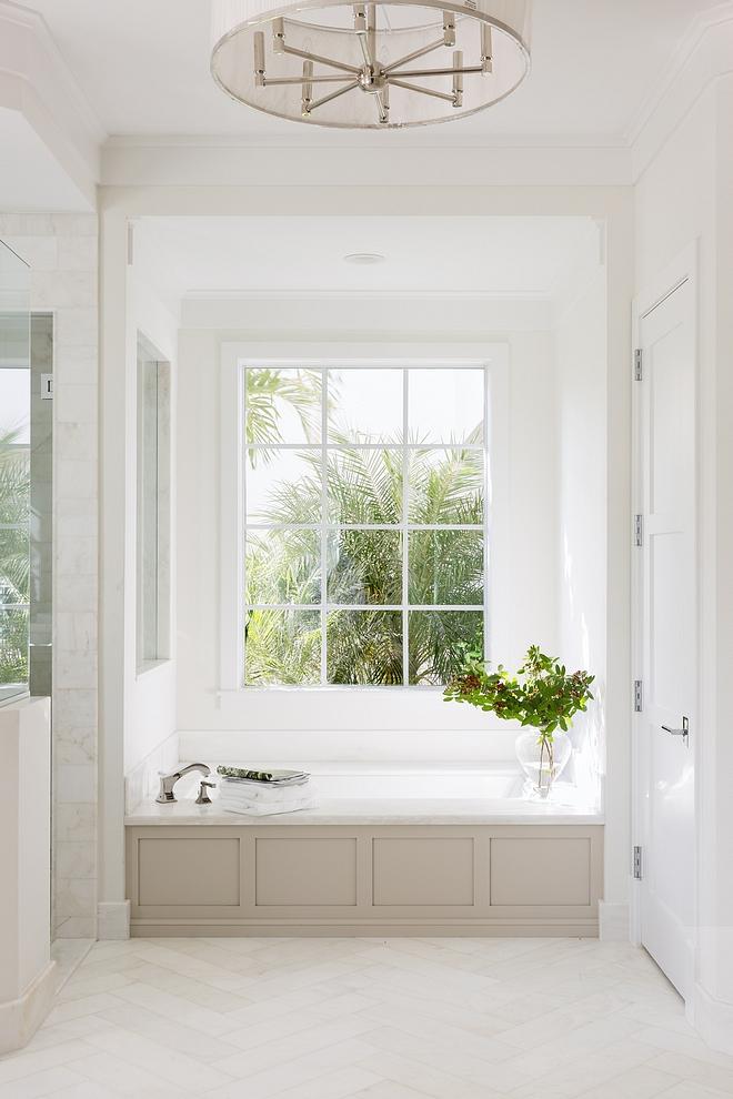 Neutral Bathroom Floor Tile Floor tile is Mystery White Marble honed cut 6x24 Herringbone Pattern source on Home Bunch #bathroom #tile #neutralbathroom #herringbone