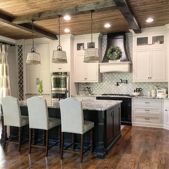 Rustic Farmhouse kitchen with white cabinets, black island and beamed V-Groove Pine Plank ceiling #FarmhouseKitchen
