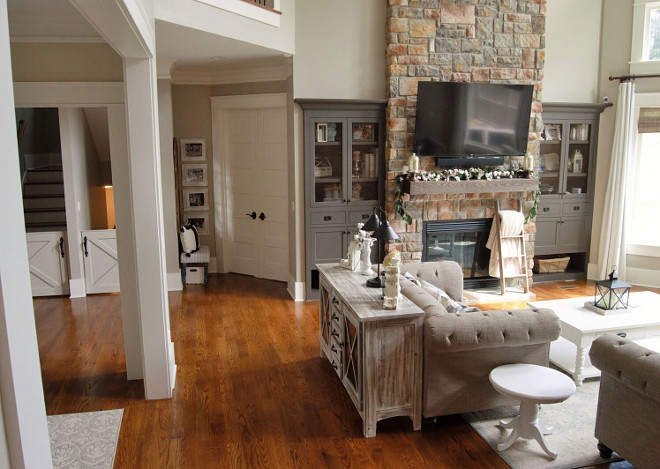 Foyer opens to great room with stone fireplace sources on Home Bunch