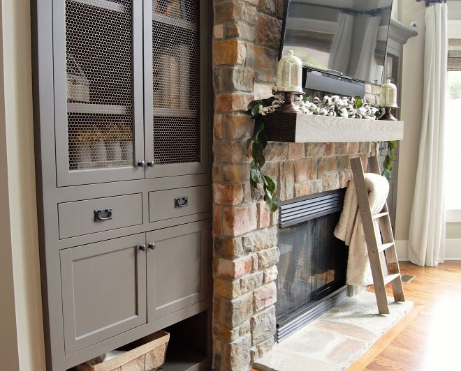 Grey Fireplace Cabinets Living room cabinets flank stone fireplace sources on Home Bunch