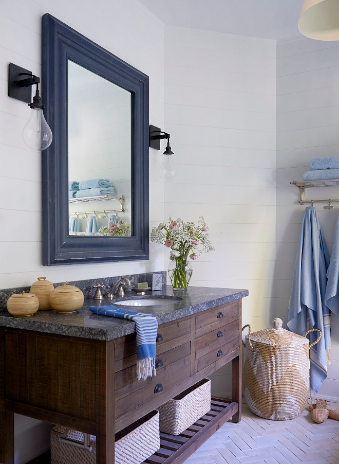 Farmhouse bathroom Farmhouse bathroom with reclaimed vanity with Riverrock Granite countertop, herringbone brick floor tile and shiplap #farmhousebathroom #brickflooring #herringbonebrick #shiplap